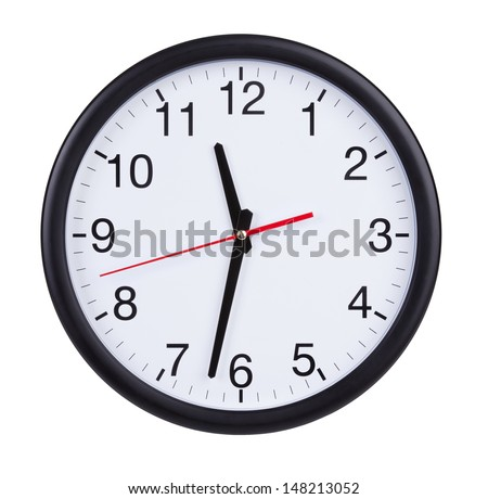 Half past eleven on a round clock face - stock photo