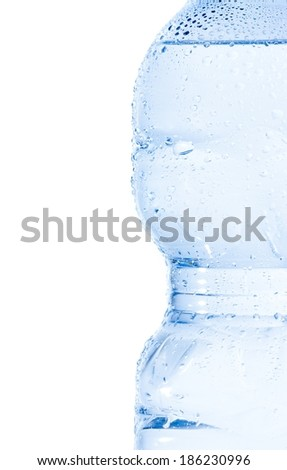 half plastic bottle with water and drops on white background, concept of nutrition and diet with space for text - stock photo
