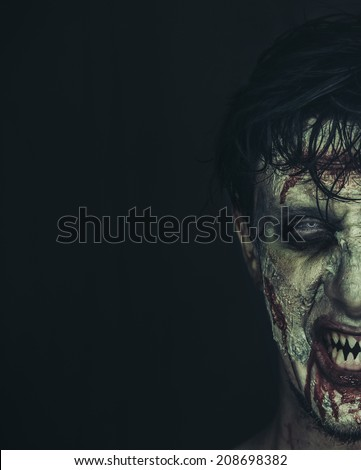 Half portrait of hungry zombie man with copy-space at left image, Halloween makeup - stock photo