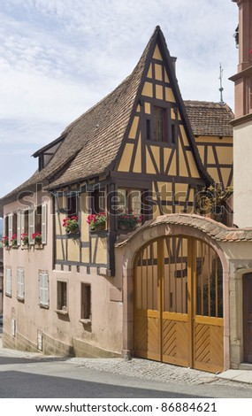 half-timbered house in Mittelbergheim, a village of a region in France named Alsace - stock photo
