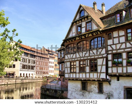 Half timbered houses along the canals of Strasbourg, France - stock photo