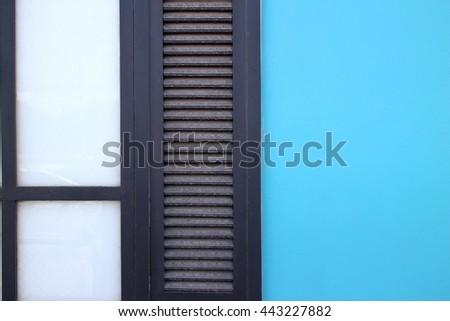 Half-wall windows with blue needles. - stock photo