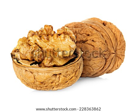 Half walnut kernel and whole walnut isolated on white background - stock photo