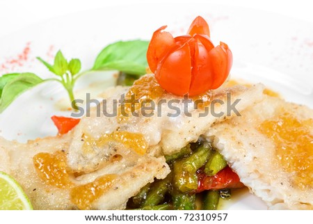 halibut filet roast at lime juice with vegetables - stock photo