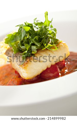 Halibut Fillet with Tomato Sauce and Rucola - stock photo