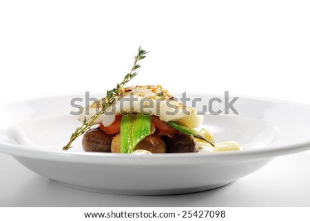 Halibut on Vegetable with Sauce. Isolated on White Background - stock photo