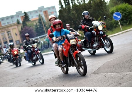 HALIC, SLOVAKIA - MAY 28: Unidentified bikers during the BIKE PARTY HALIC 2012 on May 28, 2012 in Halic, Slovakia - stock photo