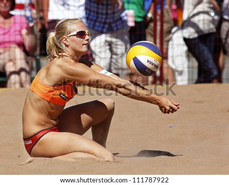 HALIFAX, CANADA - SEPTEMBER 1: Kim Behrens of Germany competes at the FIVB Beach Volleyball SWATCH Junior World Championships on Sept. 1, 2012 in Halifax, Canada. - stock photo