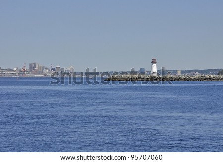 Halifax Harbour entrance , Mc Nabs lighthouse with Halifax in the far background; Halifax Nova Scotia Canada - stock photo