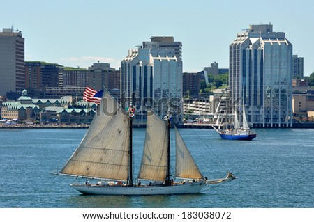 HALIFAX - JULY 20: Tall ships in Halifax Harbor during the highlight of the event, the parade of sail on July 20, 2009 in Halifax, Nova Scotia, Canada.  - stock photo