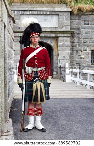 HALIFAX, NOVA SCOTIA, CANADA - SEPTEMBER 19, 2011: A Canadian sentry guards the entrance to the Citadel (Fort George) in this Canadian city. This is a National Historic Site.
