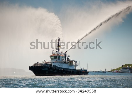HALIFAX, NOVA SCOTIA - JULY 20: A fire boat pumps water in celebration during the Tall Ships Nova Scotia festival, July 20, 2009 in Halifax. - stock photo