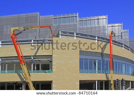 HALIFAX, UK – SEPTEMBER  15: Cranes being used in the construction of the Broad Street  Shopping development. September 15, 2011 Halifax, West Yorkshire - stock photo