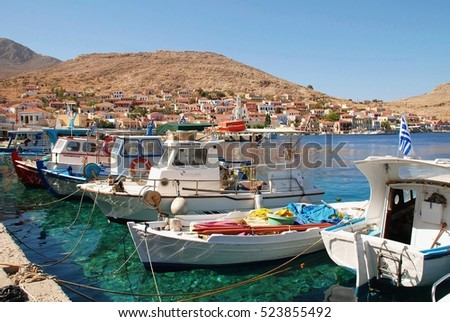 HALKI, GREECE - JULY 16, 2016: Small boats moored in the harbour at Emborio on the Greek island of Halki. Tourism and fishing are the main industries on the small Dodecanese island.