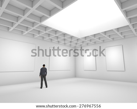 Hall for exhibitions with blank canvas and figure of man - stock photo