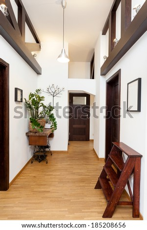 Hall in a white and brown modern house - stock photo
