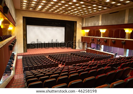 Hall of a cinema and lines of red armchairs with Clipping Paths - stock photo