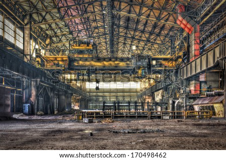 Hall of a disused metalworking plant - stock photo