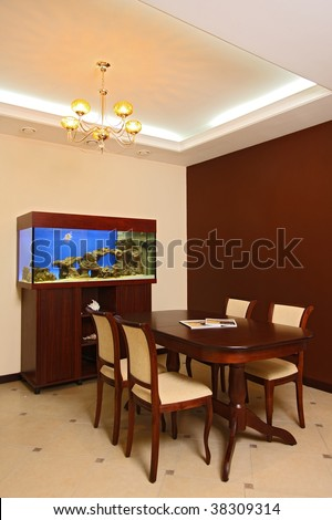 Hall with a sea aquarium, a table and a door