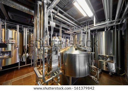 Hall with brewing equipment - stock photo
