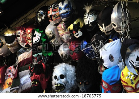 Halloween and Mexican wrestling masks on Olvera Street - stock photo