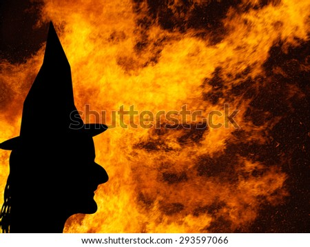 Halloween background. Real bonfire. Not real witch. - stock photo
