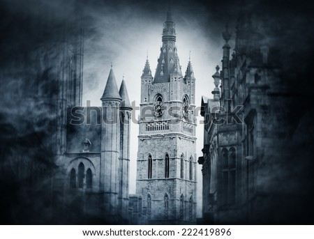 Halloween background with spooky and ancient buildings over smoky background  - stock photo