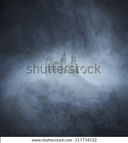 Halloween background with spooky and ancient castle on the mountain  - stock photo