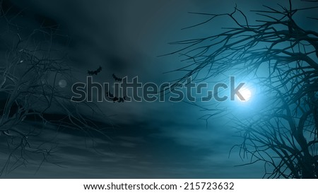 Halloween background with spooky trees against a moonlit sky - stock photo