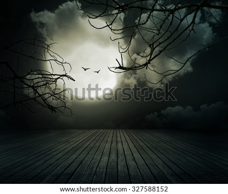 Halloween background, Wooden floor with branch and blurred full moon, Dark style. - stock photo