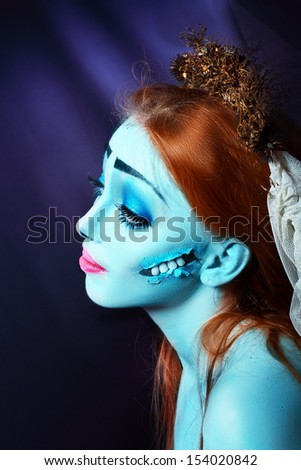 Halloween beautiful model with perfect corpse bride make up close up. Pretty zomdie or ghost concept. Sad hero - stock photo