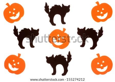 Halloween black cat and orange jack o lantern foam cut outs isolated on white - stock photo