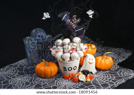 Halloween Boo Bowl, Ghosts, and Skeleton Candy - stock photo