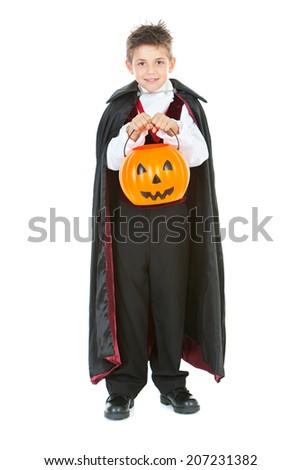 Halloween: Boy Vampire With Pumpkin Bucket Trick Or Treating - stock photo