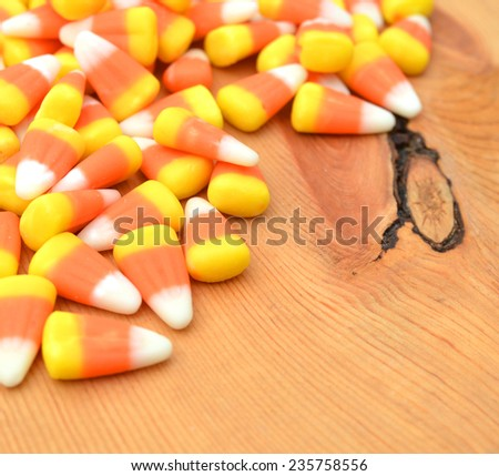 Halloween candy corn corner border over wooden board - stock photo