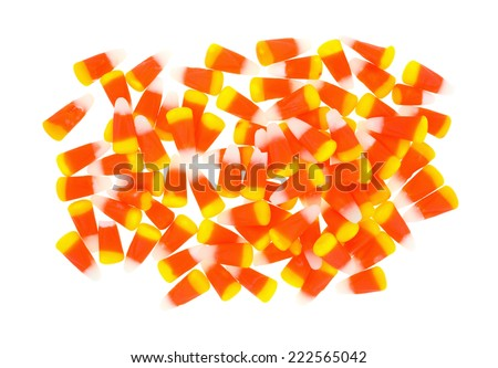 Halloween candy corn kernels portion on a white background. - stock photo