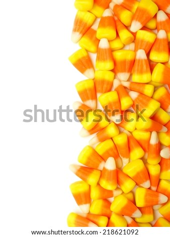Halloween candy corn vertical border over white - stock photo