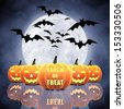 Halloween carved pumpkins , full moon and bats - stock photo