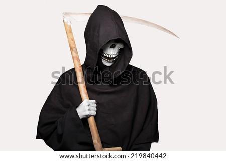 Halloween character: grim reaper. Studio portrait isolated on white background - stock photo