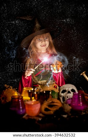 Halloween. cheerful little witch with a magic wand  - stock photo