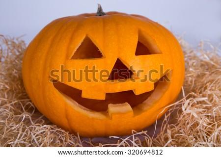 Halloween concept - big pumpkin Jack-O-Lantern with happy face - stock photo