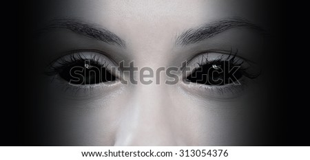 Halloween concept, close up of evil female eyes - stock photo