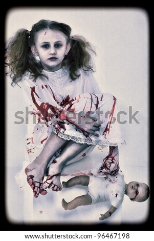 Halloween Concept Image of Ghost Girl in Blood with Doll - stock photo