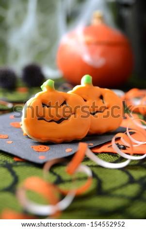 halloween cookies formed as pumpkins - stock photo