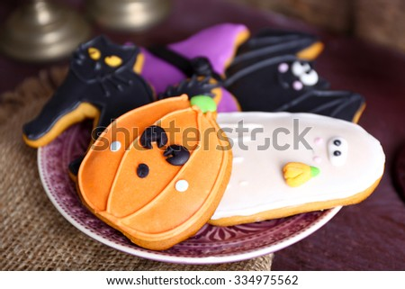 Halloween cookies on decorated table - stock photo