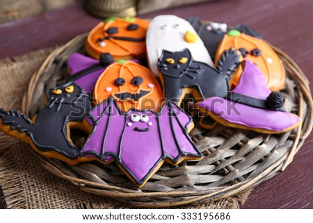 Halloween cookies on wattled plate - stock photo
