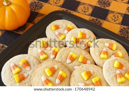 Halloween cookies with candy corns on a black plate - stock photo