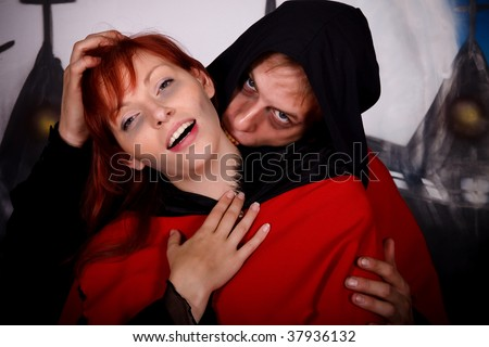 Halloween couple horror character vampire. Studio, painted themed background. - stock photo