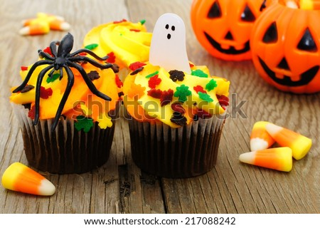 Halloween cupcakes and candy on wooden table