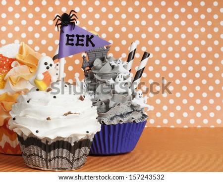 Halloween cupcakes on an orange background - stock photo